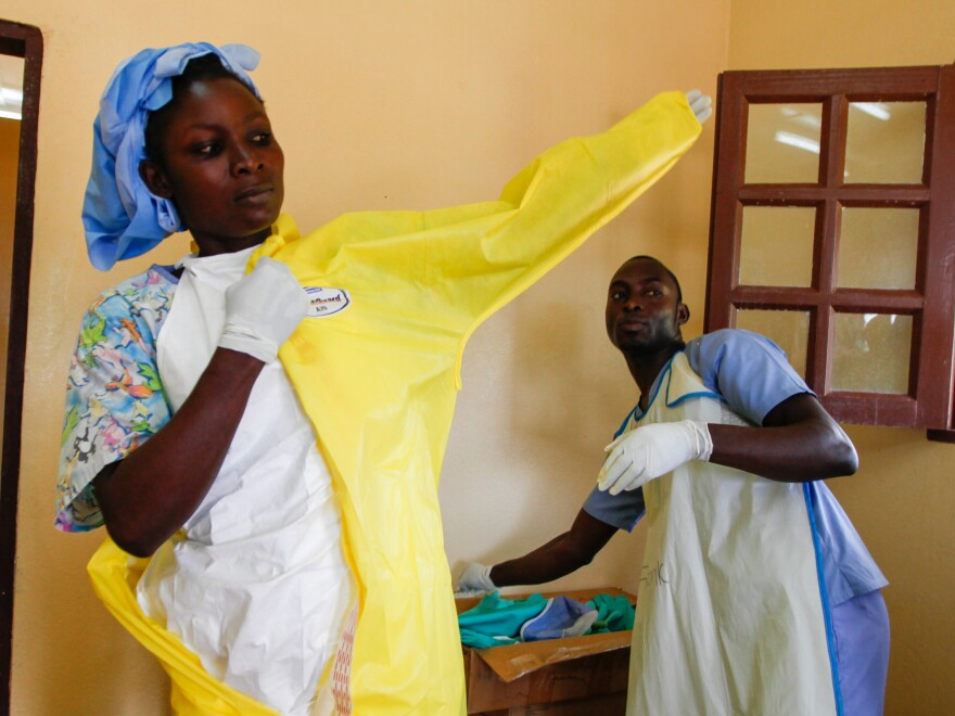 Nurse Monika Mulbah suits up before entering the Ebola ward at Firestone's clinic. Currently there are three patients, ages 4, 9 and 17.