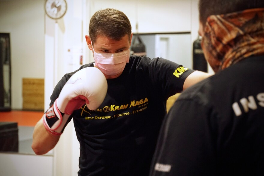 Kristian Foster sports a mask to follow St. Louis County's new restrictions on gyms while throwing punches Tuesday Nov. 17, 2020 at Xtreme Krav Maga in Fenton.