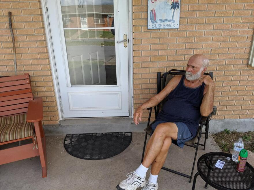 Boca Chica resident Gale McConnaughey sits on a porch
