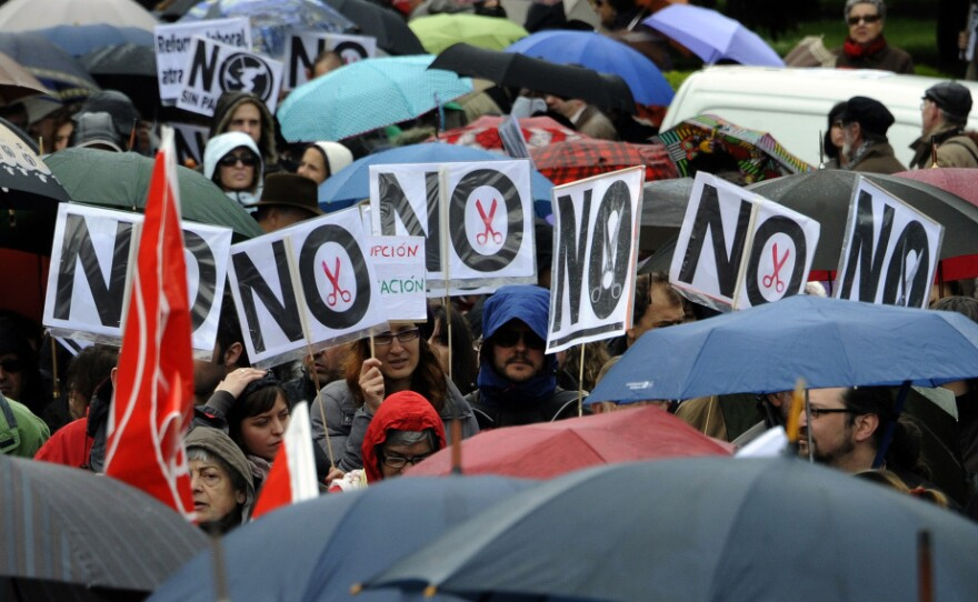 People attend a demonstration in Madrid organized by unions against financial cuts in health and education on April 29.