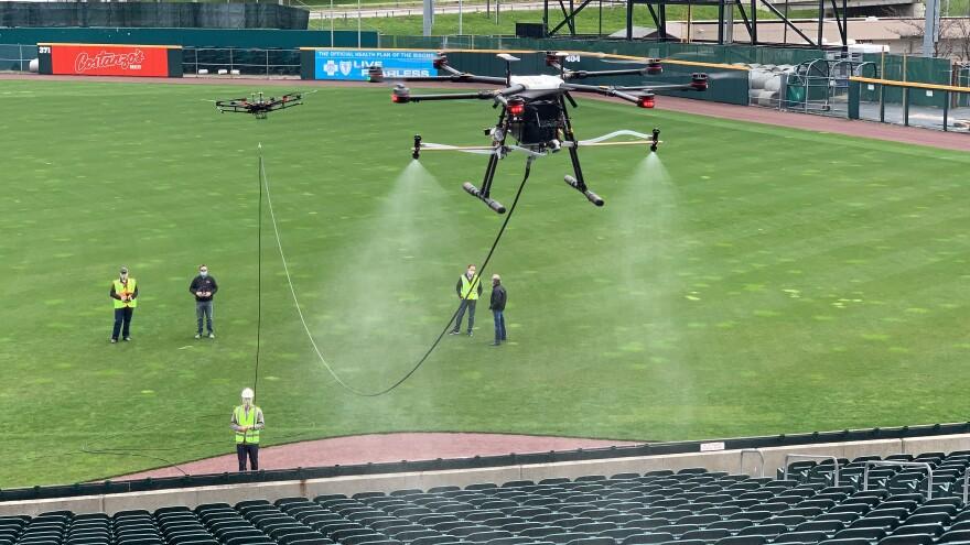 An EagleHawk drone sprays disinfectant on seats in Sahlen Field in Buffalo, New York.