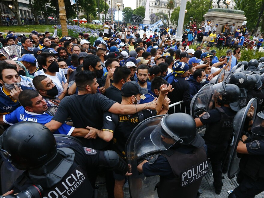 Police block soccer fans waiting to see Diego Maradona lying in state in Buenos Aires on Thursday.