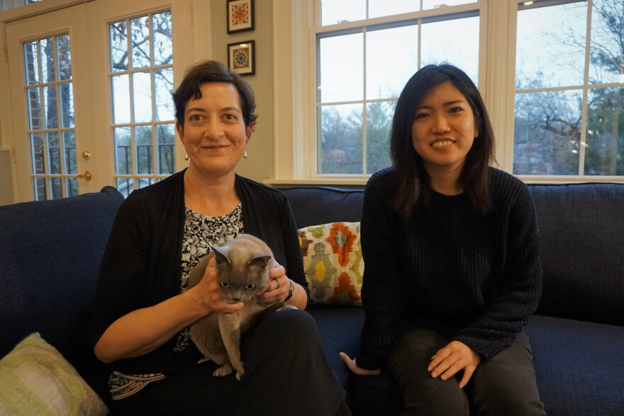 """Amy Taylor and Yuki Hanashiro live together in Taylor's house in University City. Also pictured: Taylor's cat, Sophie, a former beauty queen """"best in show"""" contestant."""