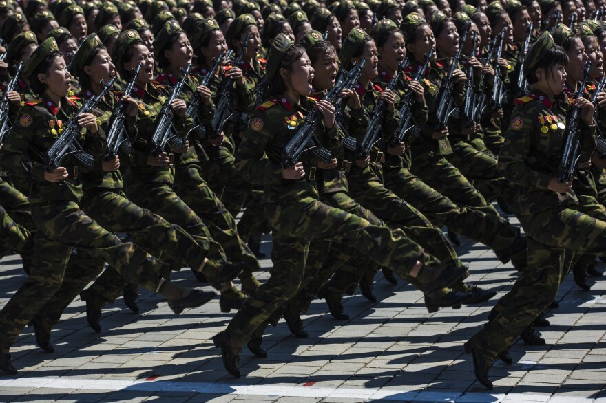 North Korean military goose-step on Kim Il Sung Square in Pyongyang during a mass military parade to mark its 70th anniversary as a nation.