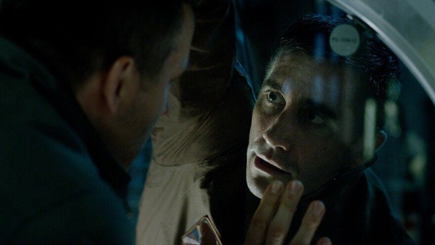 """The needs of the many ..."": Astronauts Rory (Ryan Reynolds) and David (Jake Gyllenhaal) in <em>Life</em>."