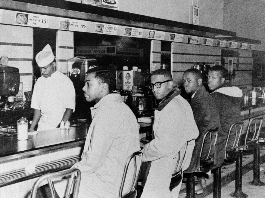 "(From left) Joseph McNeil and Franklin McCain, two of the Greensboro Four who the day before had sat at the ""whites only"" counter of a Woolworth store, came back on Feb. 2, 1960, with two others — Billy Smith and Clarence Henderson."