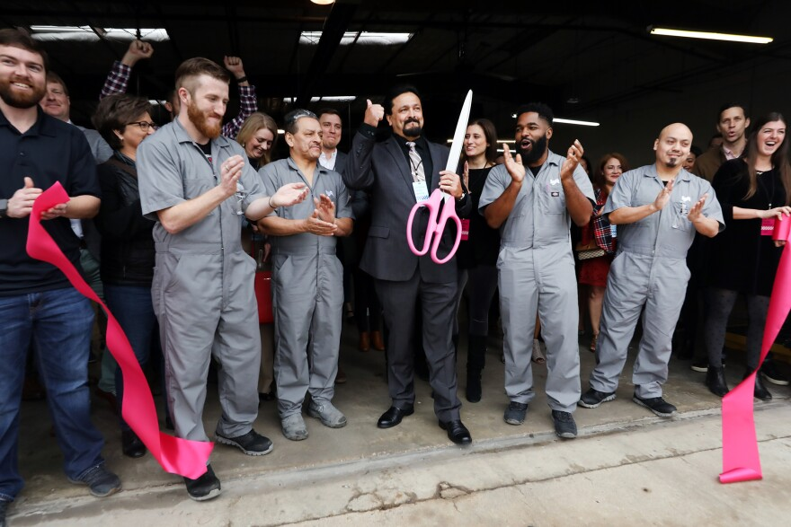Austin Lyft Driver cuts the ribbon at the Austin Driver Center grand opening.