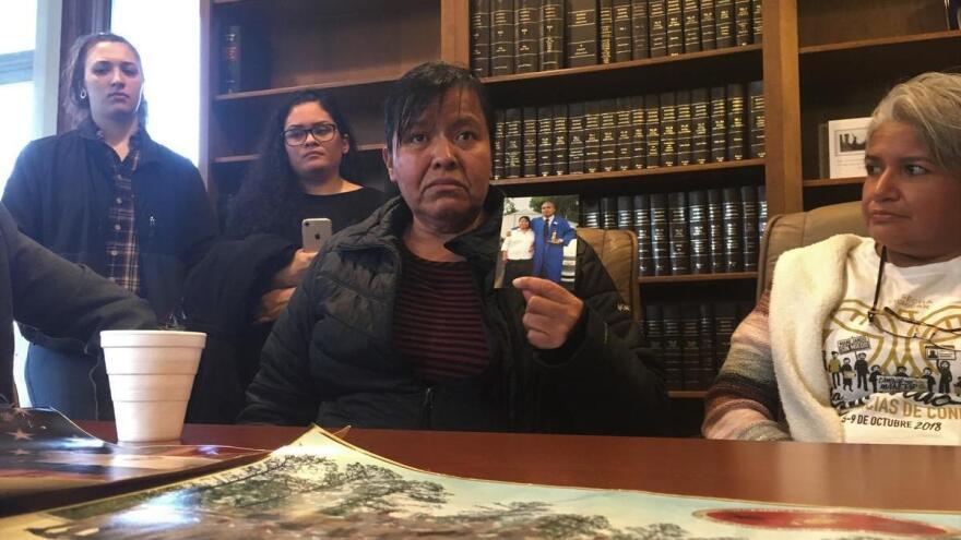 Maria Gomez-Velasquez holds a picture of her son Jilmar Ramos-Gomez.