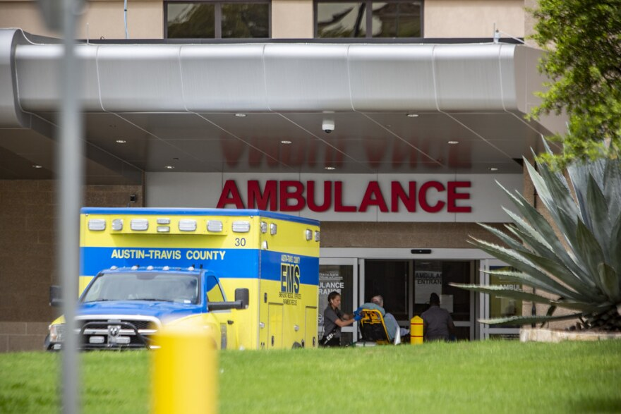 An ambulance parked outside St. David's South Austin Medical Center.