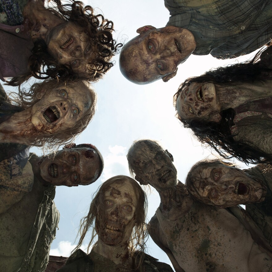 "A crowd of zombies, known as ""walkers,"" on AMC's <em>The Walking Dead.</em>"