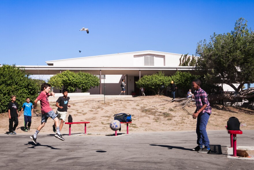 On their lunch break, Incubator students Jack Cohen, Angel Bautista and Ray-Jean Boyd play a game of soccer on the school grounds that are colocated with Westchester High School.