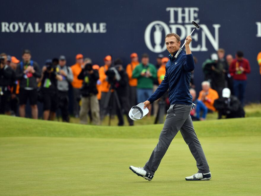 Jordan Spieth celebrates on the 18th green after his final round 69 to win the 2017 Open Golf Championship at Royal Birkdale golf course in England on July 23, 2017.