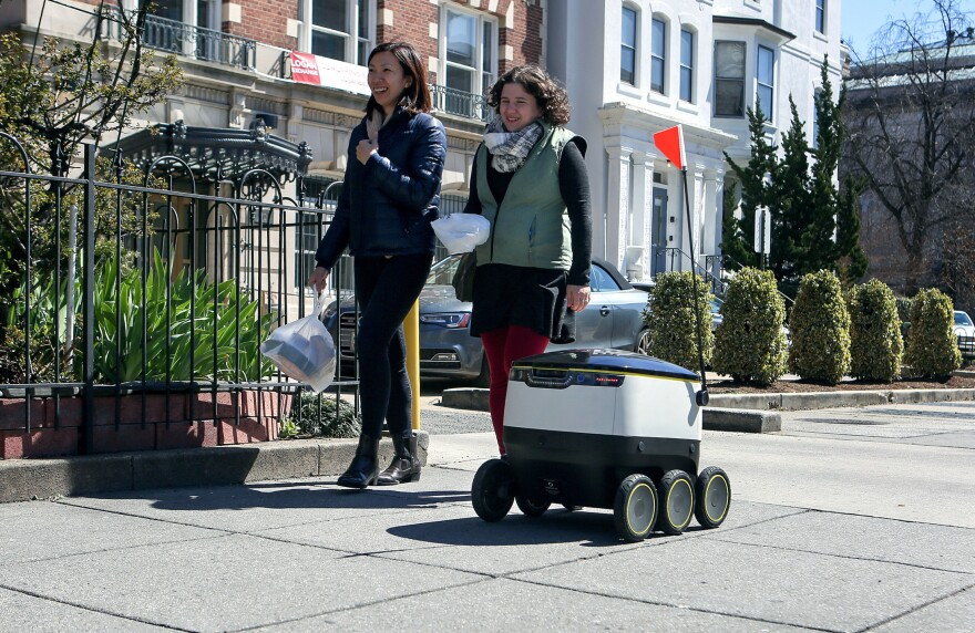 The delivery bot zips its way down a Washington, D.C., sidewalk during a demonstration of the autonomous machine.