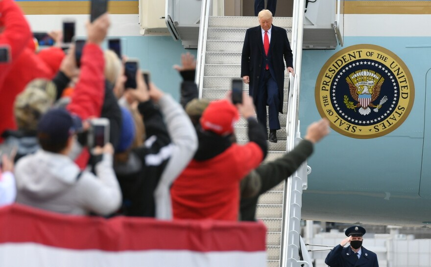 President Trump arrives Sunday to speak at a campaign rally at Manchester-Boston Regional Airport in Londonderry, N.H.