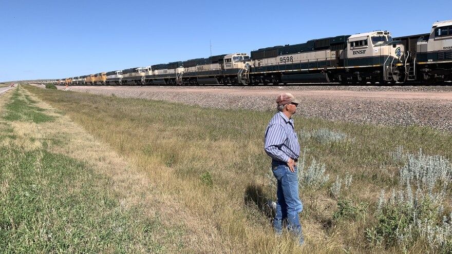 In Gillette, Wyo., miner Bill Fortner stands by stalled trains that normally would be transporting coal. Local production has declined by one-third in the past decade.