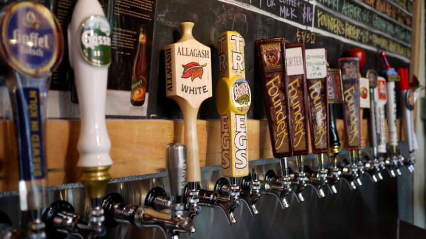 A row of taps highlights specialty and imported beers at Brouwerij Lane, in Brooklyn, New York. Craft brewers have found a way to thrive, even as the U.S. economy struggles.