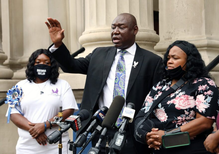 Attorney Benjamin Crump (C) addresses the media over a series of meetings they've had with Kentucky Attorney General Daniel Cameron as Breonna Taylor's mother Tamika Palmer (R) and aunt Bianca Austin (L) look on outside Louisville City Hall in Louisville, Kentucky.