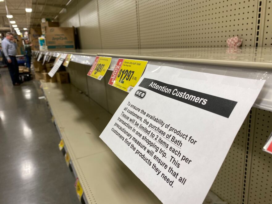 A sign at H-E-B tells customers they are limited to two items of bath tissue per shopping visit.