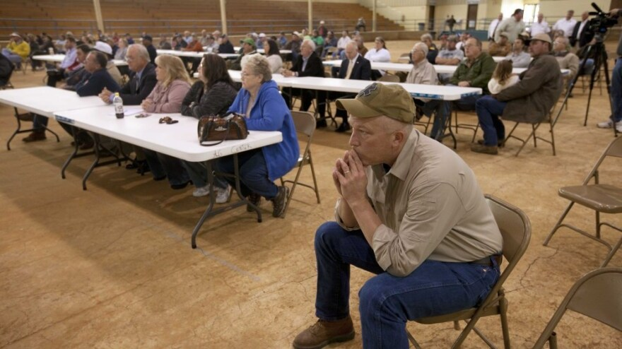 <p>Farmer Scott Allgood, front, of Allgood, Ala., listens during a meeting of farmers and state officials to discuss the impact of the Alabama Immigration law on their livelihoods in Oneonta, Ala.</p>