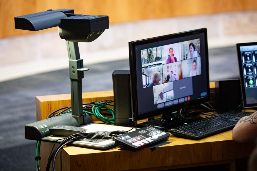 Tech set up to handle city officials on Zoom during a City Council meeting last week.