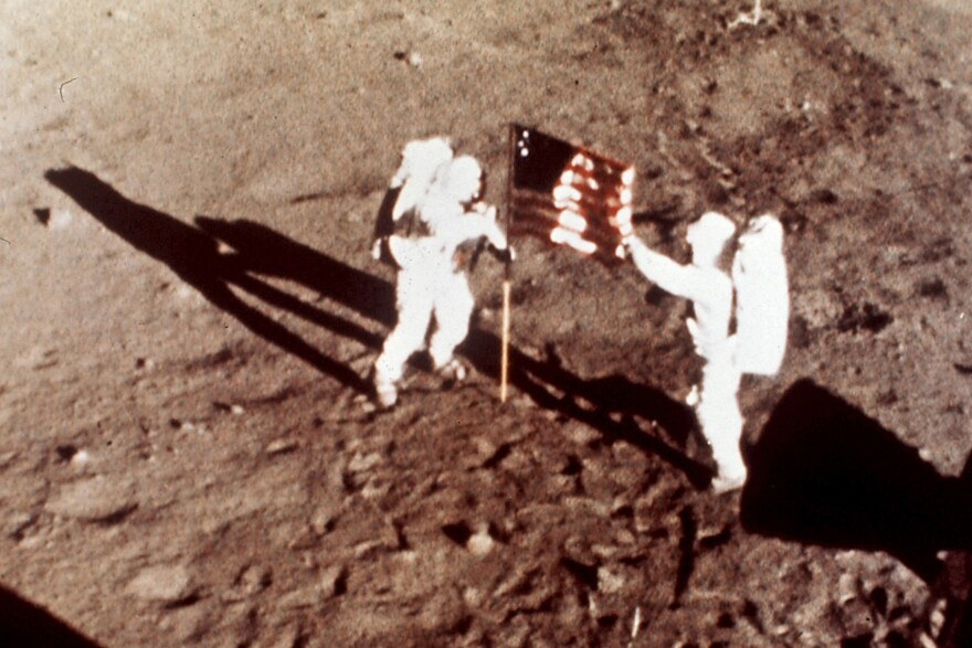 "Apollo 11 astronauts Neil Armstrong and Edwin E. ""Buzz"" Aldrin, the first men to land on the moon, plant the U.S. flag on the lunar surface, July 20, 1969. (NASA via AP)"