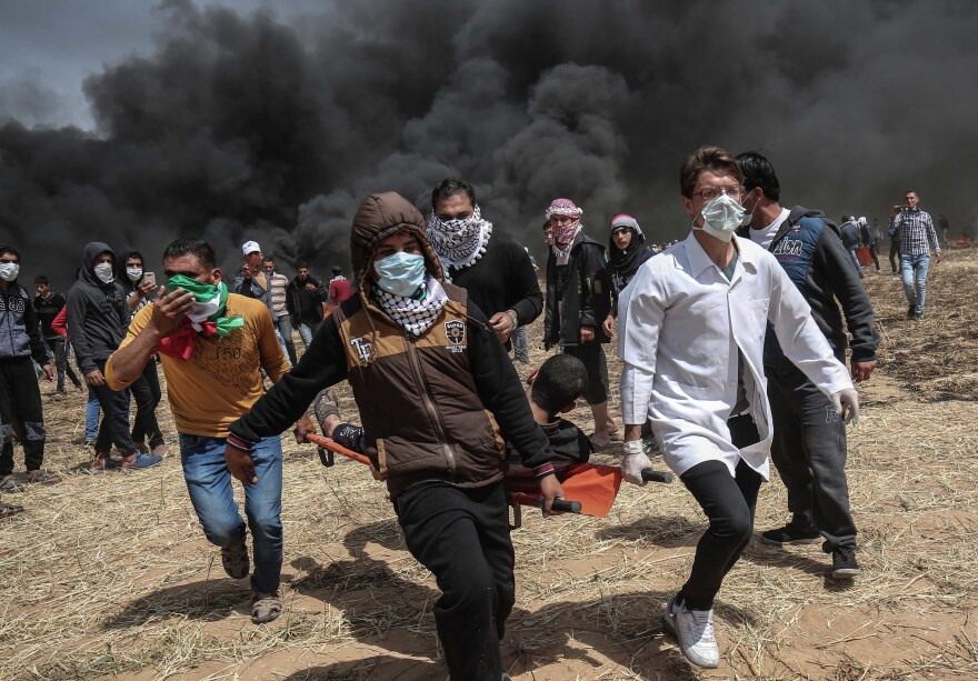 An injured Palestinian protester is carried by fellow demonstrators during a protest east of Khan Yunis in Gaza.