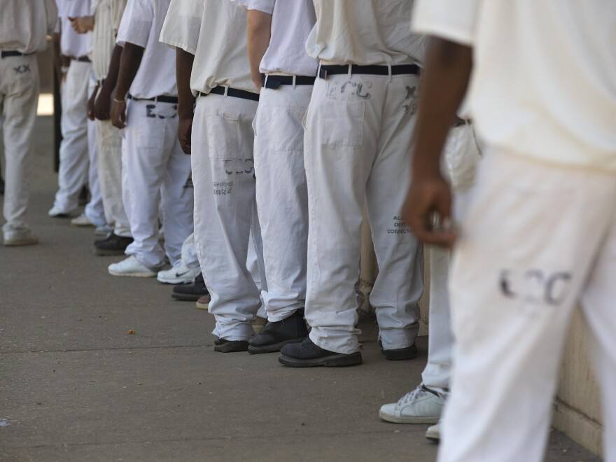 Prisoners stand in a crowded lunch line at Elmore Correctional Facility in Elmore, Ala. in June 2015. On Saturday, a U.S. District Court Judge determined the state's Department of Corrections had not adequately addressed a spike in prisoner suicides.
