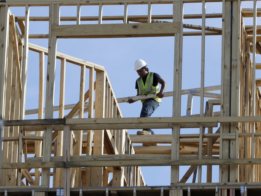 A construction worker at an apartment and retail complex in Nashville. The U.S. economy grew at a less-than-expected 2.6 percent pace in the fourth quarter.