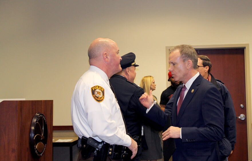 St. Louis County Police Chief Jon Belmar speaks with Special Agent in Charge James Shroba before the DEA news conference announcing the federal agency's new, more comprehensive strategy on Thurs. Jan. 28, 2016.