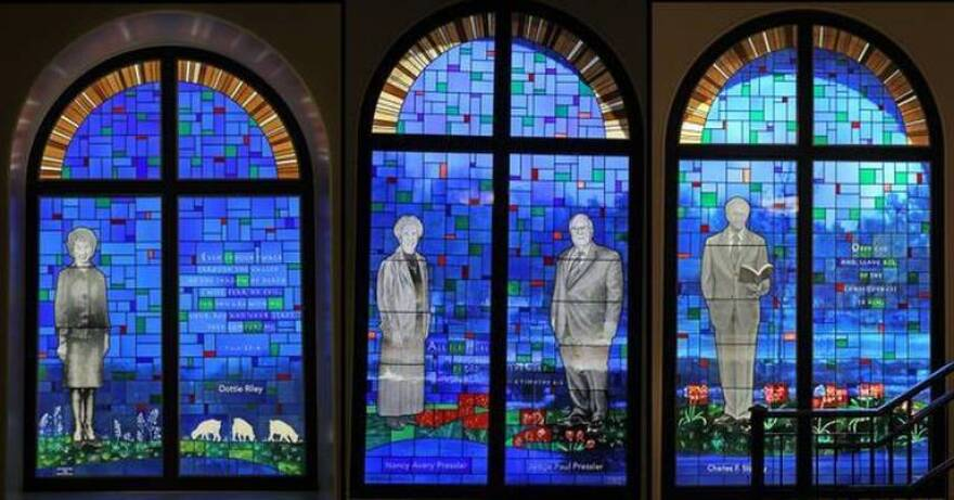 This Dec. 12, 2013, photo shows a composite of three different windows designed for the Southwestern Baptist Theological Seminary MacGorman Chapel in Fort Worth. Former Texas judge Paul Pressler is second from right.