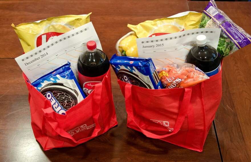 Researchers created the bag on the left as an example of groceries bought in December while those on the right show groceries bought in January. After the New Year, some shoppers add healthier items to their carts but end up taking home more calories than they do during the holidays, a study found.