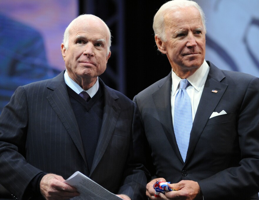 Sen. John McCain, R-Ariz., receives the Liberty Medal from former Vice President Joe Biden (right) in October 2017. Biden is one of many pallbearers who will serve at ceremonies honoring McCain this week.