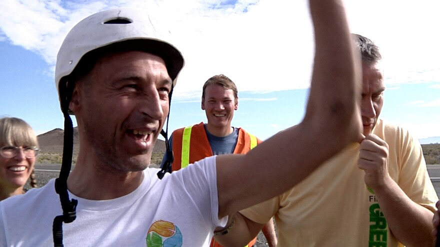British cyclist Graeme Obree, 48, celebrates setting the land speed record for prone cycling at the International Human Powered Vehicle track near Battle Mountain, Nevada.