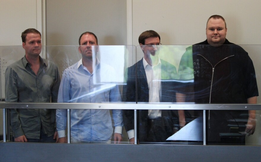 Megaupload.com employees Bram van der Kolk, also known as Bramos (from left); Finn Batato; Mathias Ortmann; and founder, former CEO and current Chief Innovation Officer Kim Dotcom appear in North Shore District Court in Auckland, New Zealand, on Friday.