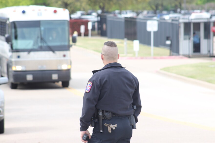 """Buses, at least one of which said LaSalle Corrections Transport, left CVE a few hours after the raid began, presumably with undocumented workers inside. Some demonstrators yelled toward one of the buses, """"We see you, we love you."""""""