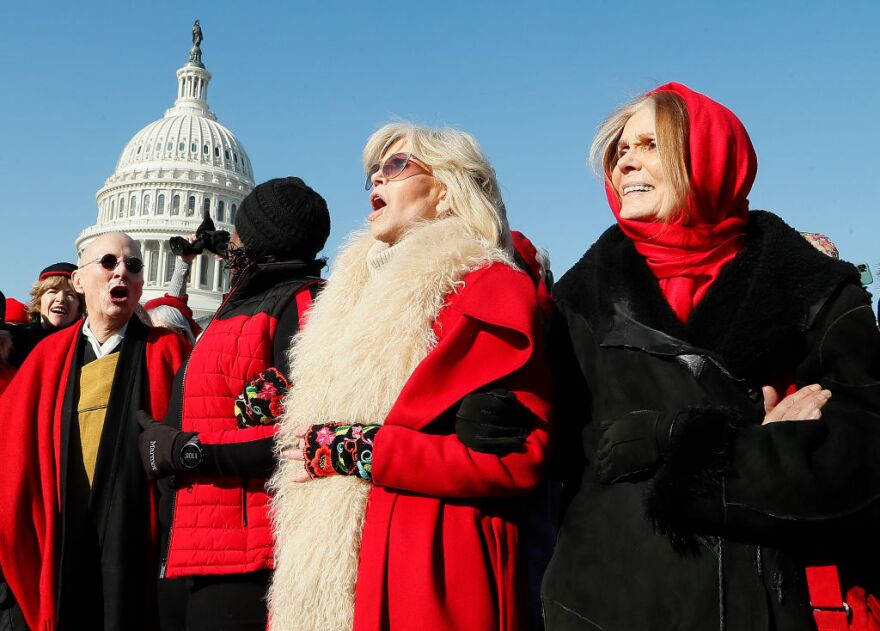 """Actress and activist Jane Fonda (center) and Gloria Steinem (right) march during the """"Fire Drill Fridays"""" climate change protest and rally on Capital Hill on December 20, 2019, in Washington, D.C. (Paul Morigi/Getty Images)"""