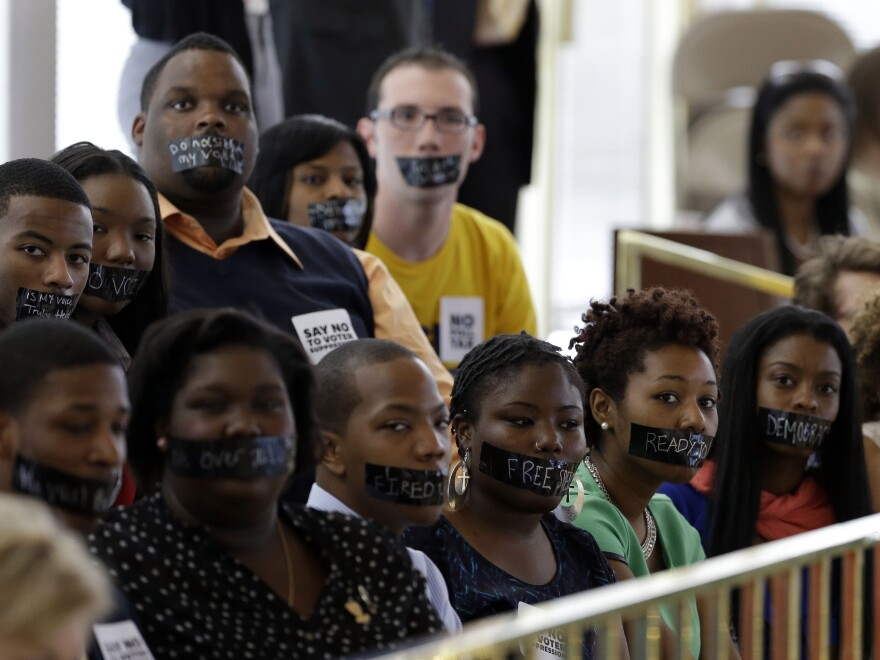 Opponents of voter ID legislation protest in the gallery of the House chamber of the North Carolina General Assembly, where lawmakers debated and then passed a sweeping voter identification law in April.