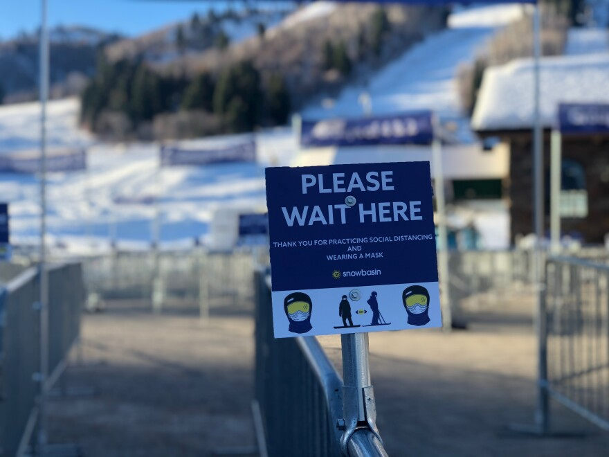 A photo of a sign at Snowbasin encouraging social distance guidelines.