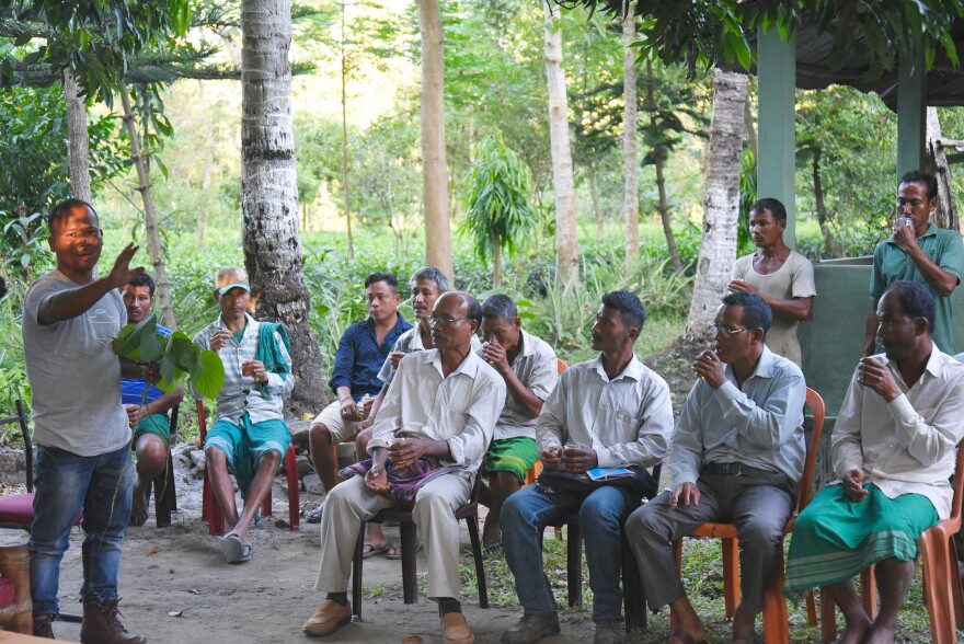 Tenzing talks with tea farmers from his large farming district on how to successfully run organic tea farms. He also discusses how best to survive in the market, where big tea growers with much cheaper rates can be more competitive.