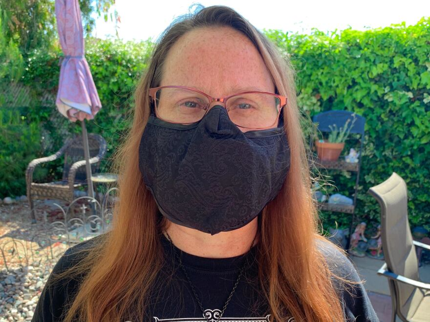 "Ralphs supermarket cashier Christine Smith finds herself flinching every time someone buys cough medicine. ""The company executives, they have their nice offices or they can work from home,"" she says. ""We don't have that option. ... And without us, they wouldn't have a company."""