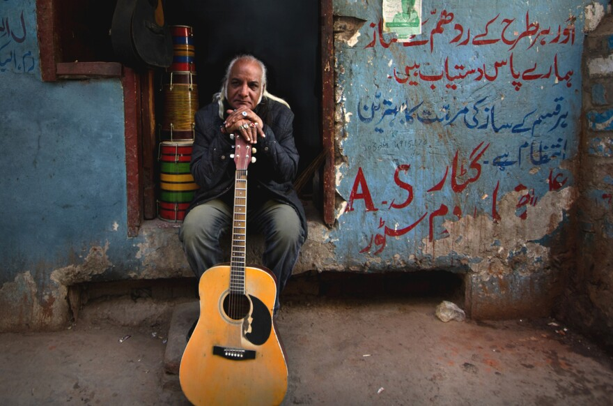 Asad Ali, 63, was unemployed for four years when Pakistan clamped down on live music in 1977. He now plays the guitar for Sachal Studios Orchestra<strong> </strong>around the globe and in his hometown, Lahore.