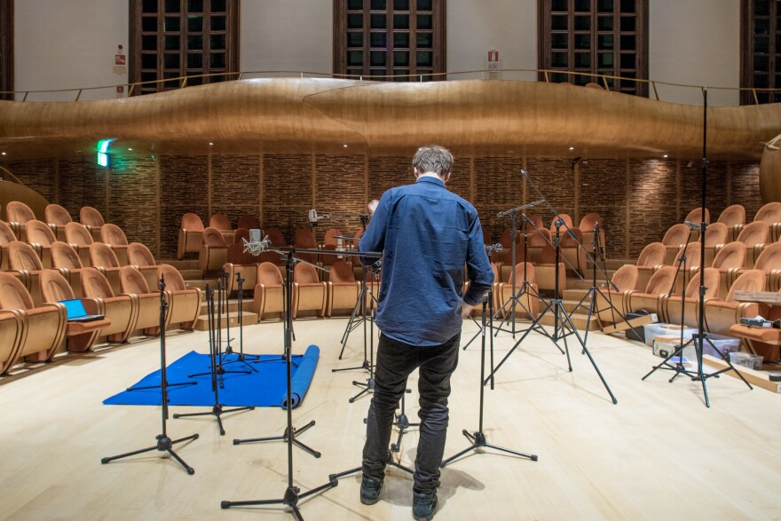 Andreas Rogge, a sound engineer with e-instruments, a German firm involved in the project, sets up microphones in the Violin Museum's auditorium.
