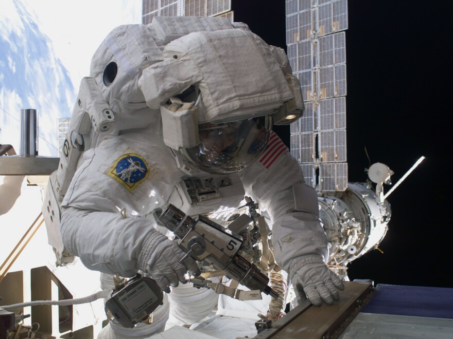 """Sunita Williams performs maintenance during a spacewalk outside the International Space Station in 2012. The astronaut has spent more than 50 hours """"spacewalking."""""""