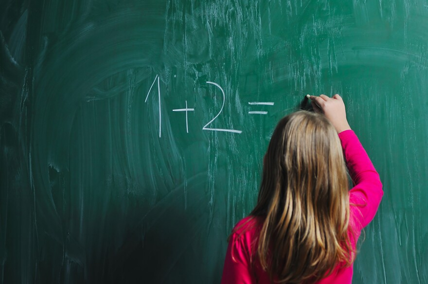 bigstock-happy-school-girl-on-math-clas-14833865.jpg