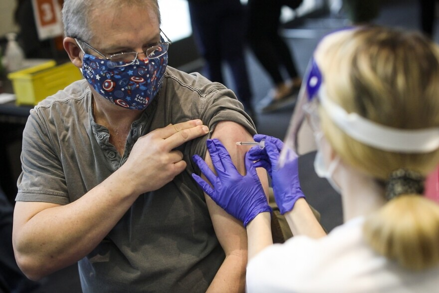 Dell Medical School Doctor Oliver Fannin receives the COVID-19 vaccine Pfizer BioNTech during injections to healthcare workers at Dell Medical School on Dec. 15, 2020. (Gabriel C. Pérez/KUT News)