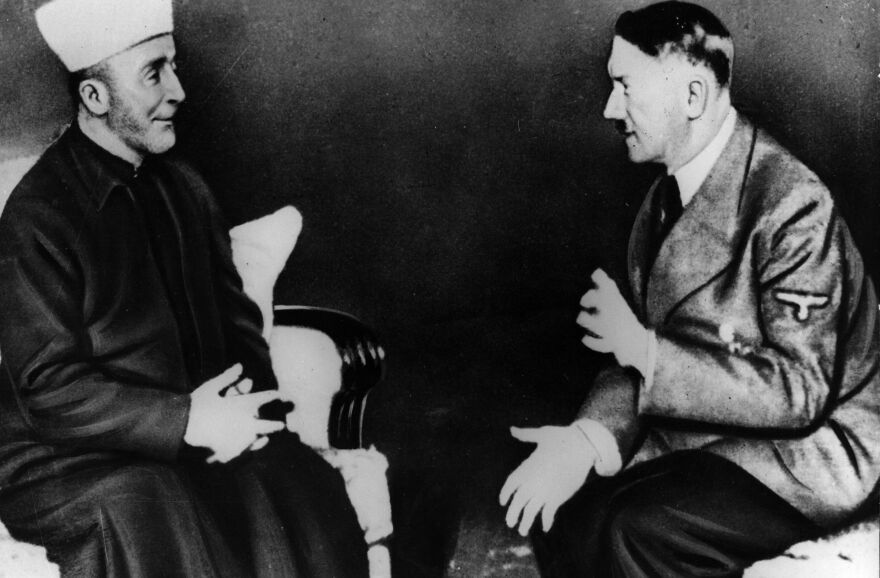 Adolf Hitler talking to Grand Mufti Haj Amin al-Husseini. Israeli Prime Minister Benjamin Netanyahu has attracted criticism after suggesting al-Husseini persuaded Hitler to carry out mass genocide against Jews.