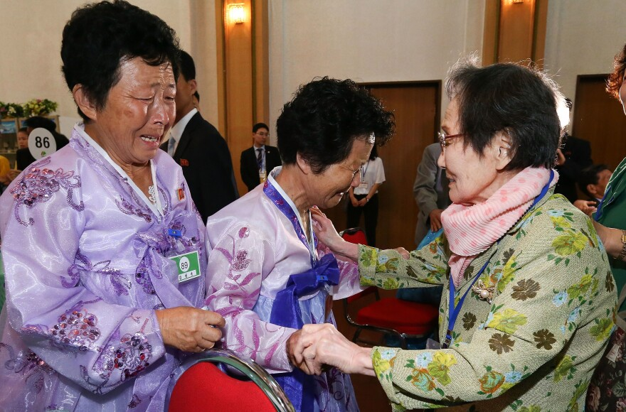 South Korean Han Shin-ja, 99, (right) meets with her North Korean daughters Kim Kyung Sil, 72, (center) and Kim Kyung Young, 71, on Monday at the Mount Kumgang resort in the North.