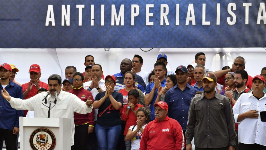 Venezuela's President Nicolás Maduro speaks to supporters during a rally at the Miraflores Presidential Palace in Caracas, Venezuela.