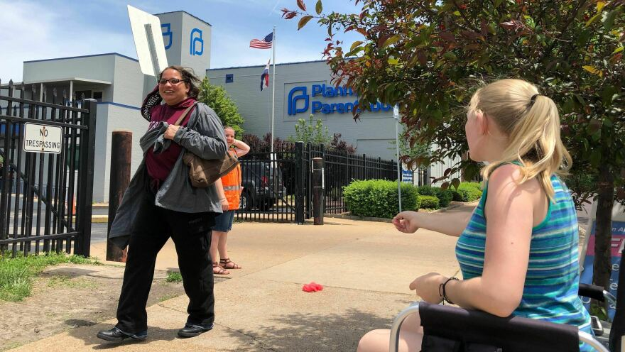 Teresa Pettis (right), an abortion opponent, protests outside the Planned Parenthood clinic in St. Louis, on May 17. Unless a judge intervenes, health officials will force a Missouri facility to stop offering the procedure this week.