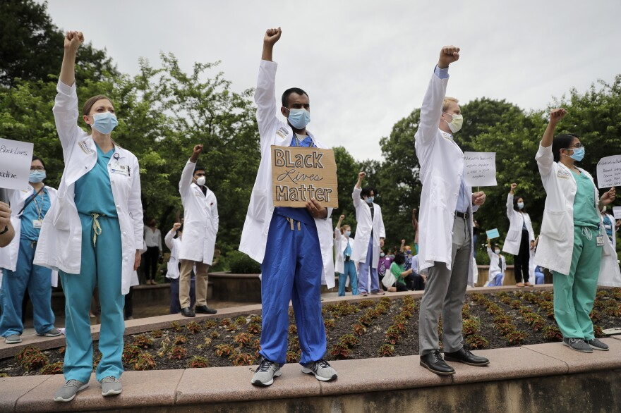 Healthcare professionals gather outside Barnes-Jewish Hospital in St. Louis to demonstrate in support of the Black Lives Matter movement on June 5. The demonstration, called 'White Coats for Black Lives,' was organized to show solidarity with those protesting the death of George Floyd after being restrained by Minneapolis police officers on May 25.